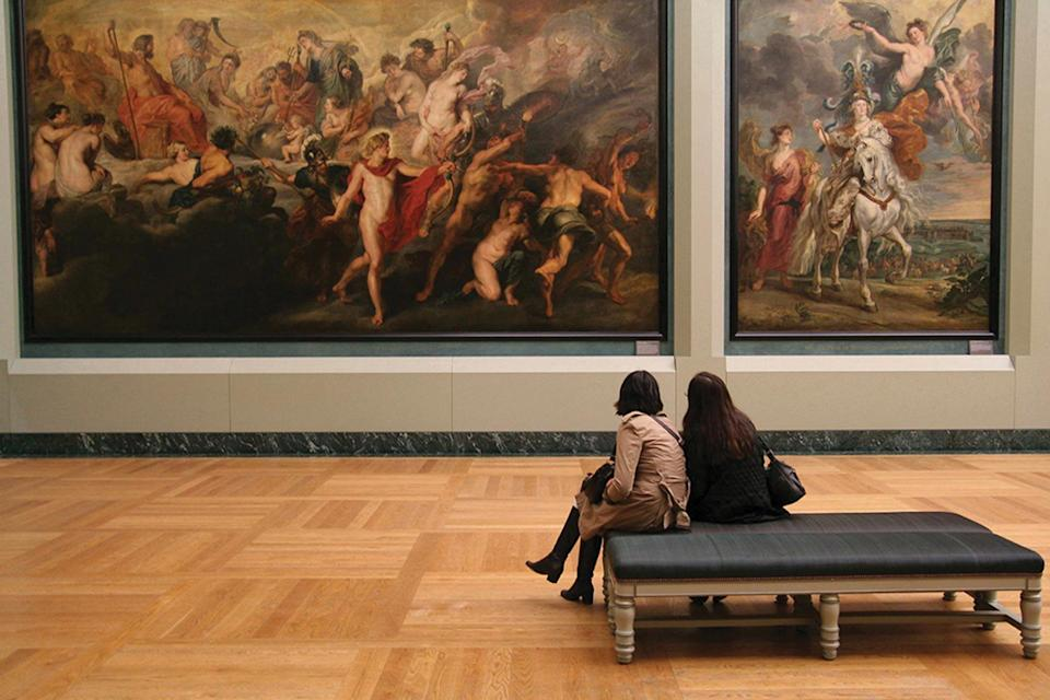 Guests on a private tour in the Louvre with Tauck, voted one of the world's best Tour Operators