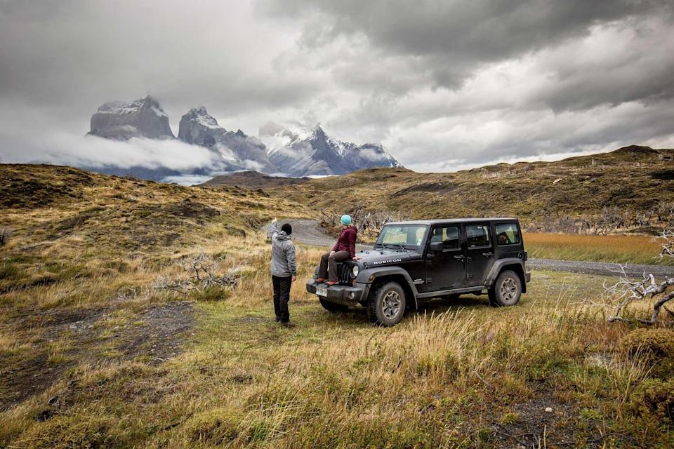 A couple in Torres del Paine, Patagonia, with a jeep from Quasar Expeditions, voted one of the world's best Tour Operators