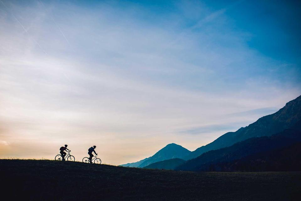Two cyclists in Slovenia to represent a cycling tour with Trek Travel, voted one of the world's best Tour Operators
