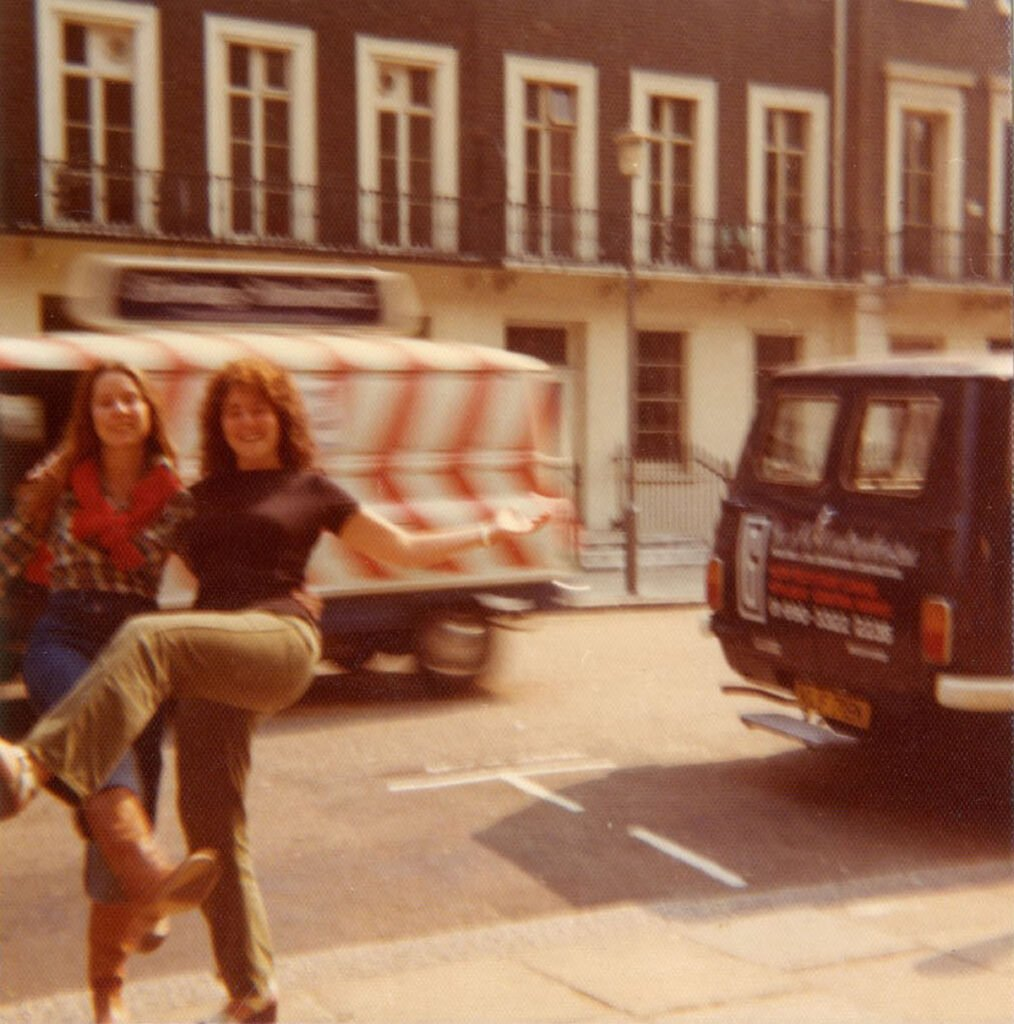 Author and tour guest dancing on streets of Europe.