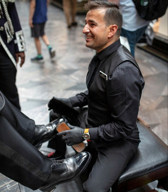 Romi Topi, a showshiner who works in Burlington Arcade, Mayfair